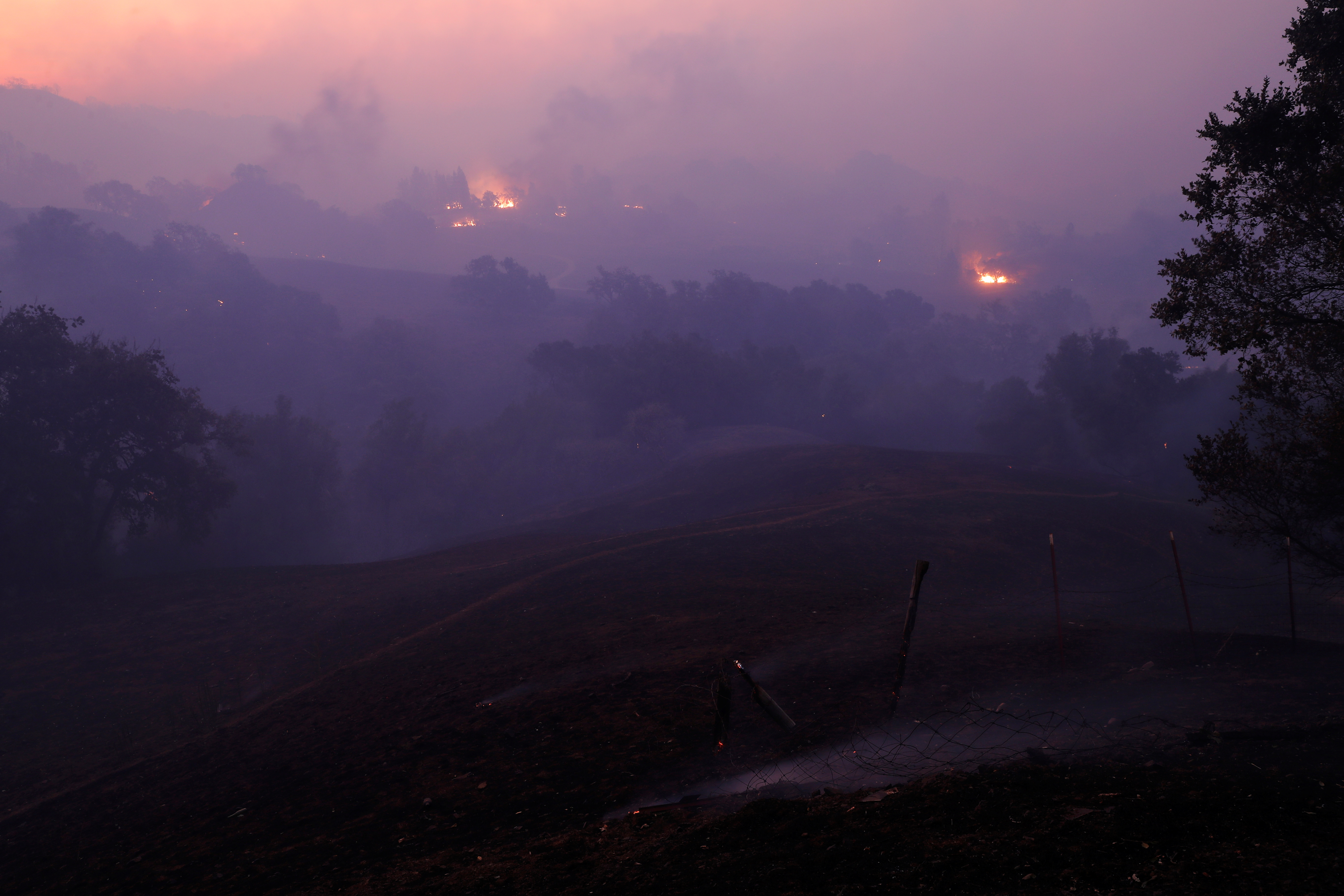 The sun rises above a smoke-filled valley during the Kincade fire in Geyserville.
