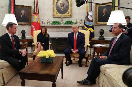 "U.S. President Donald Trump speaks about banning non-tobacco flavored vaping products next to first lady Melania Trump as Health and Human Services (HHS) Secretary Alex Azar (R) and Acting Food and Drug Administration (FDA) Administrator Norman ""Ned"" Sharpless listen in the Oval Office of the White House in Washington, U.S., September 11, 2019."
