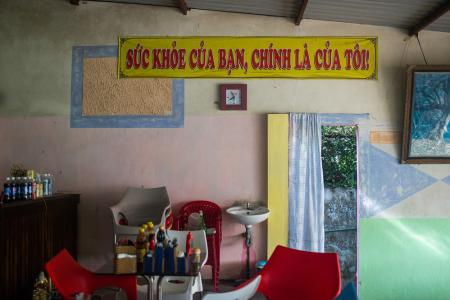 """A sign that reads """"Your Health is My Health"""" hangs in the Cafe Hua Sua"""