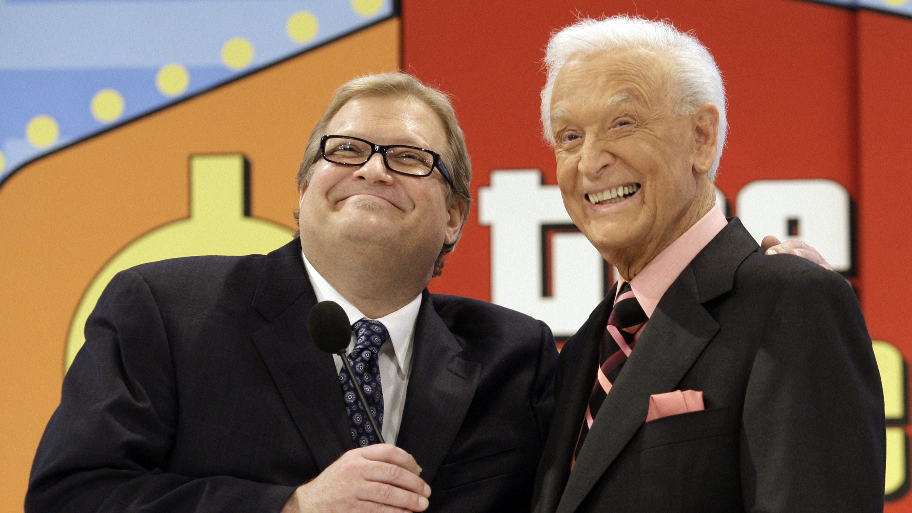 The Price is Right show host, comedian Drew Carey, left, shares a moment with longtime host Bob Barke