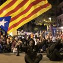 A Catalan pro-independence protester waves a Catalan independence flag