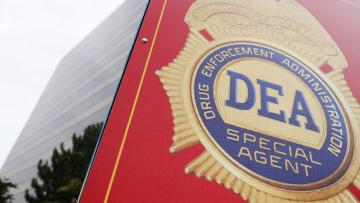 A sign with a DEA badge