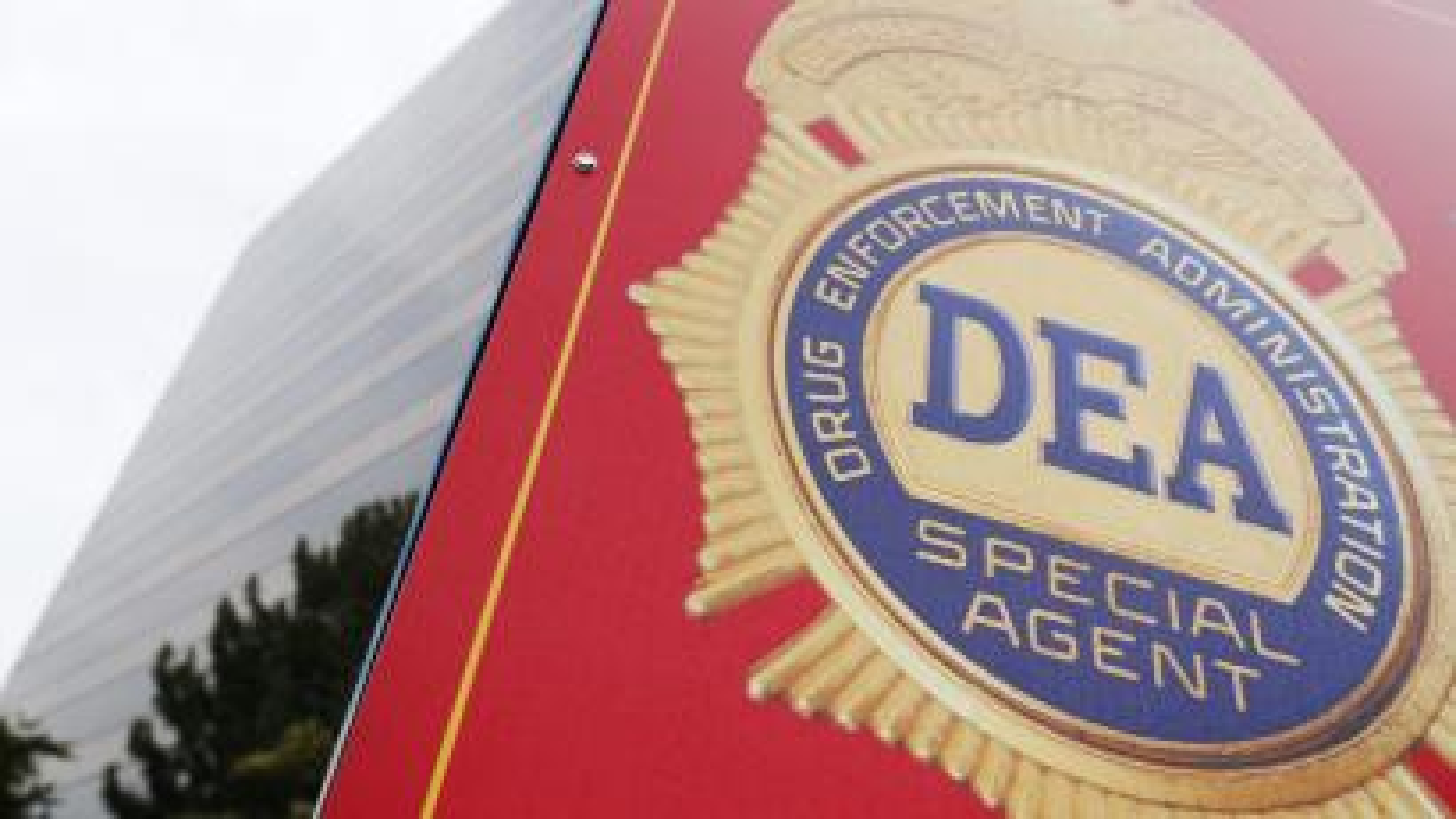 A sign with a DEA badge
