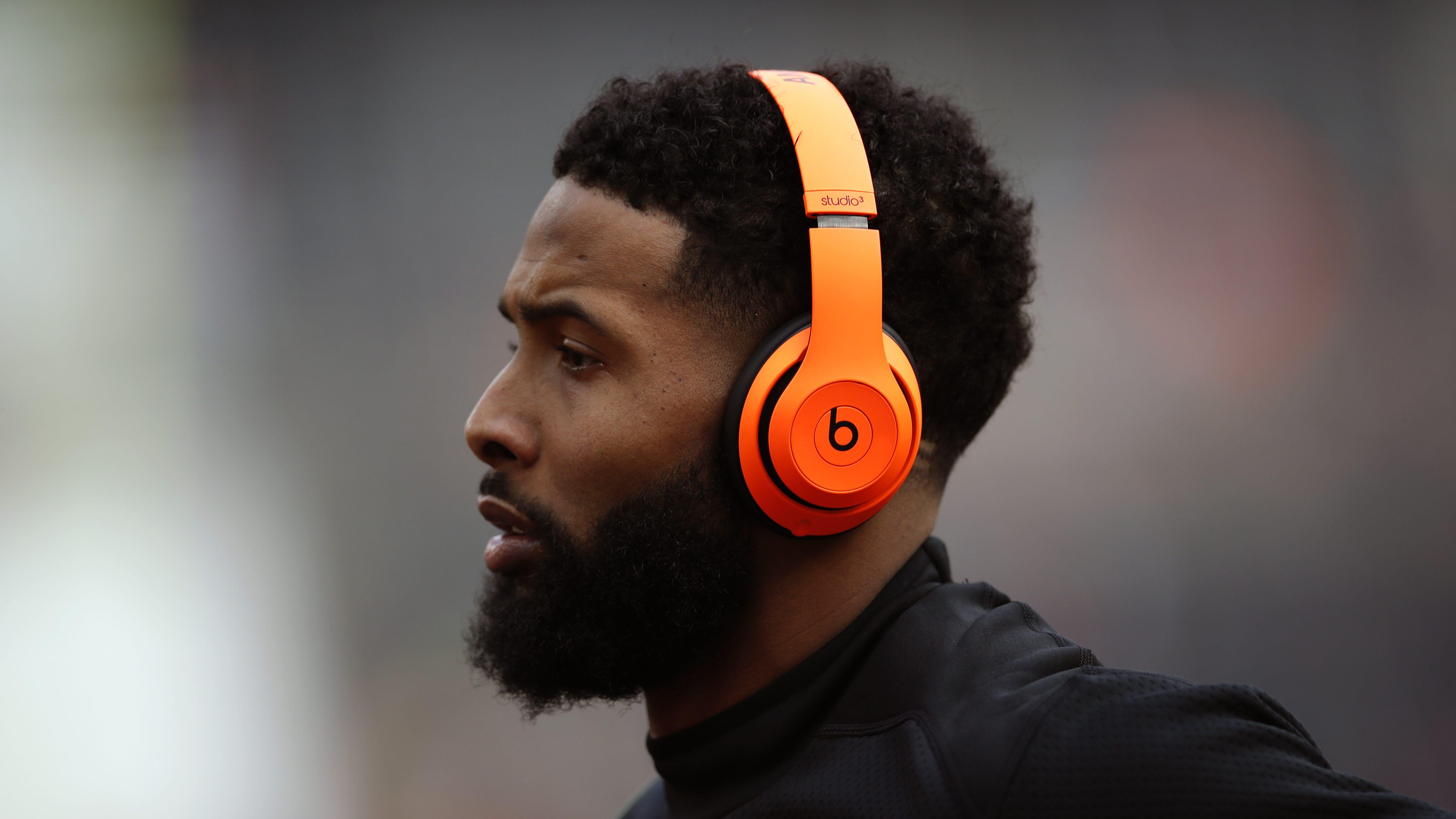 A football player wearing headphones
