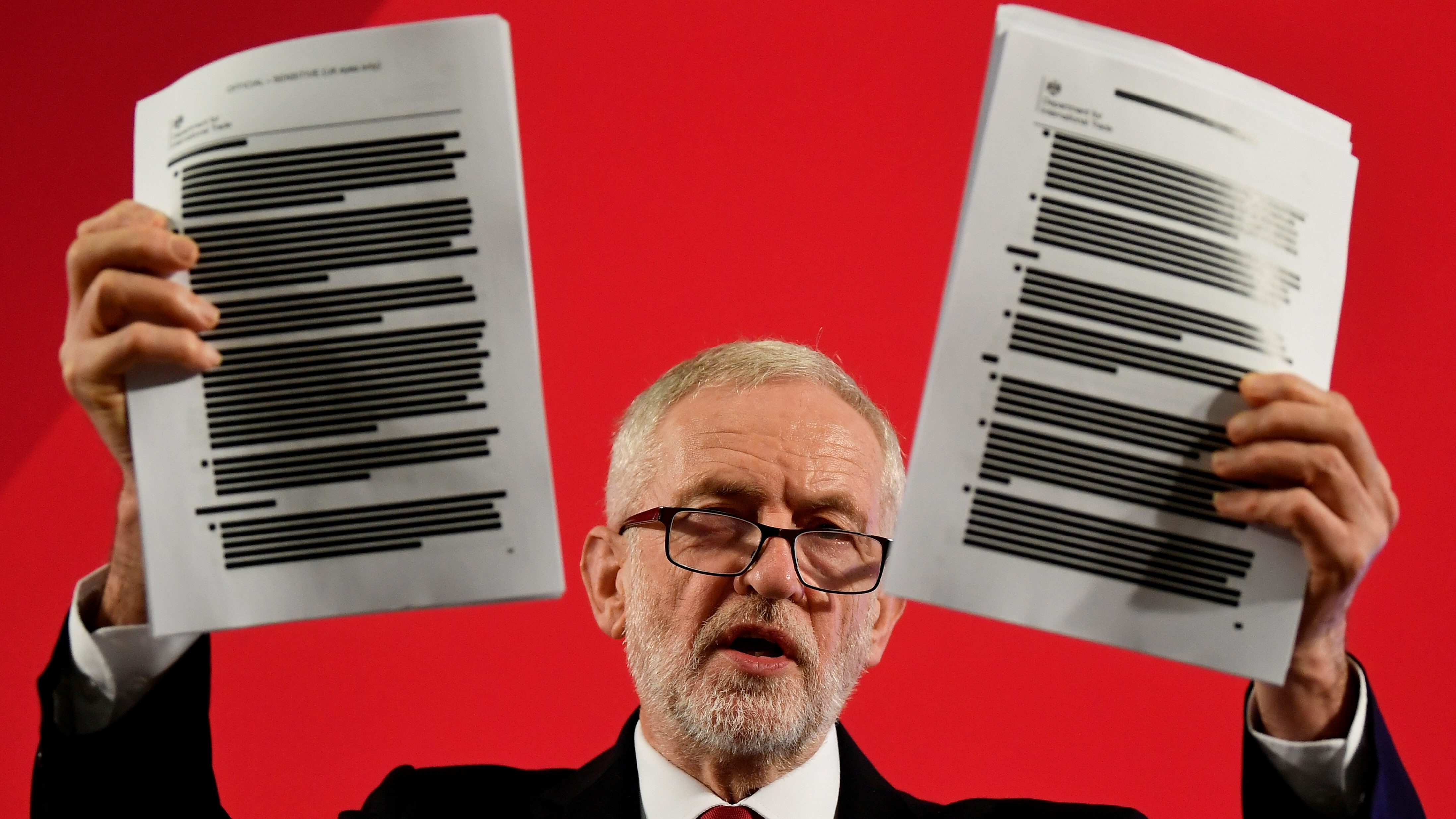 Jeremy Corbyn holds redacted documents