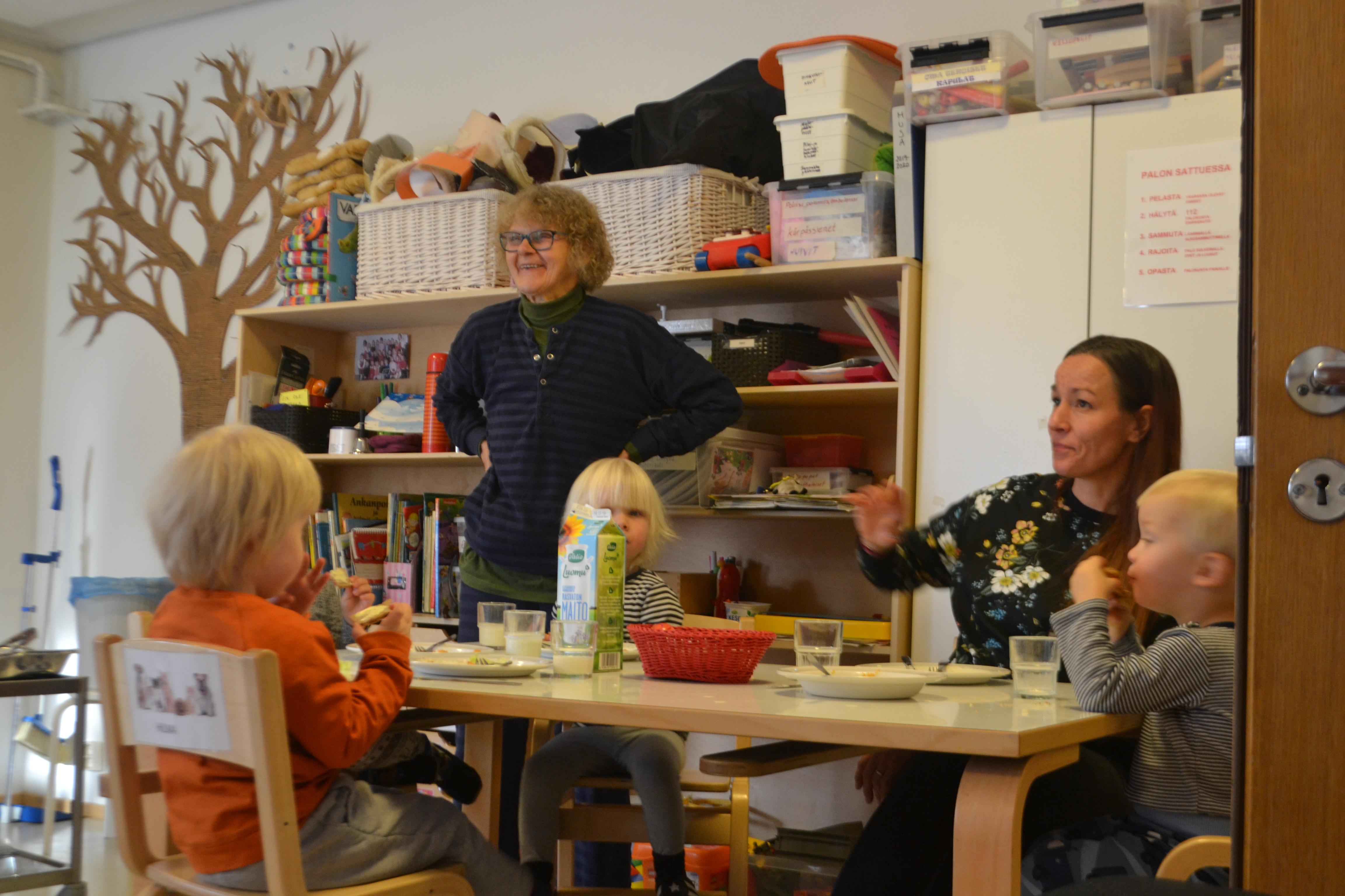 Marjatta Ahonen serves lunch with Maileena Nieminen