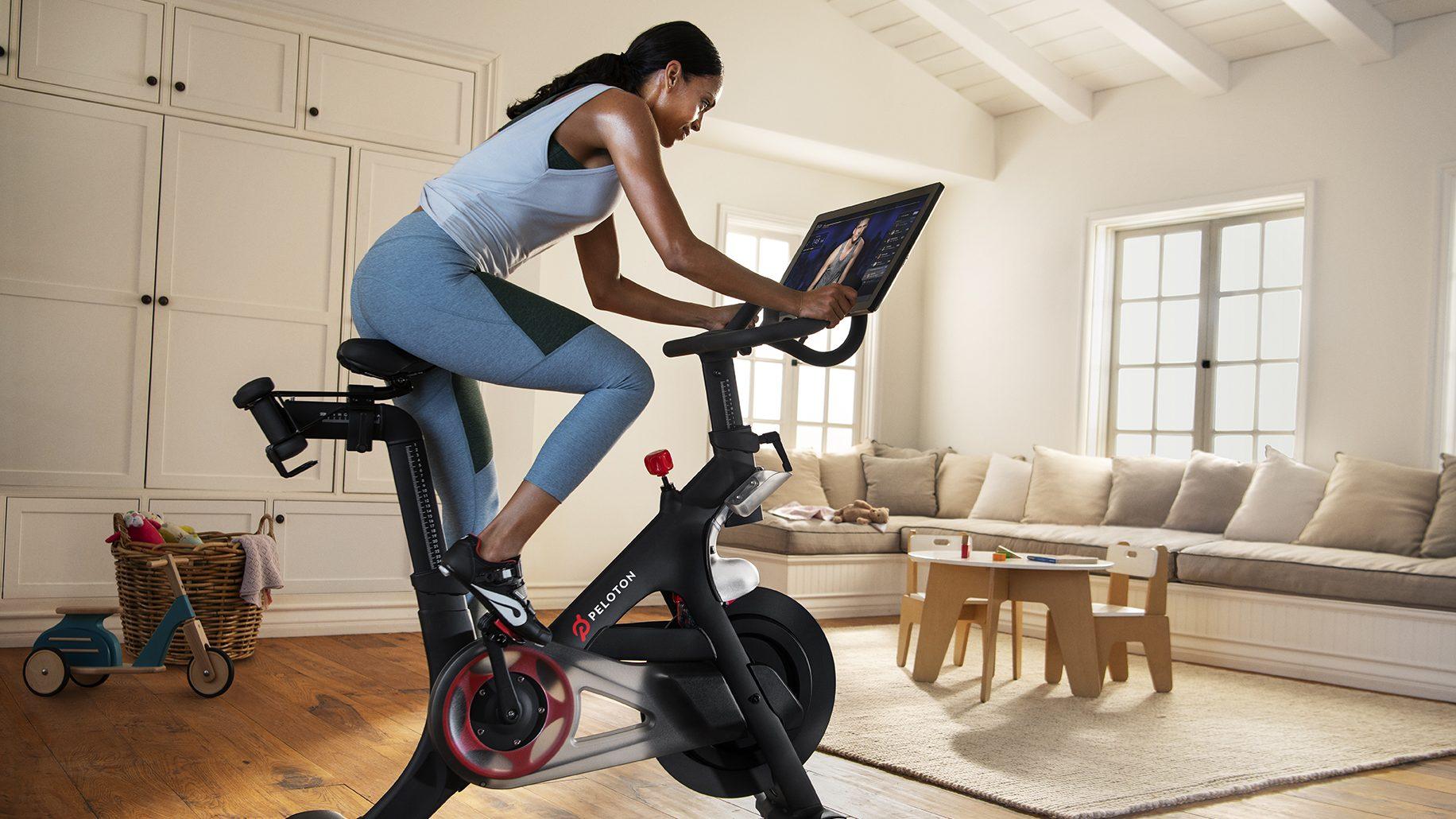 Woman on Peloton exercise bike.