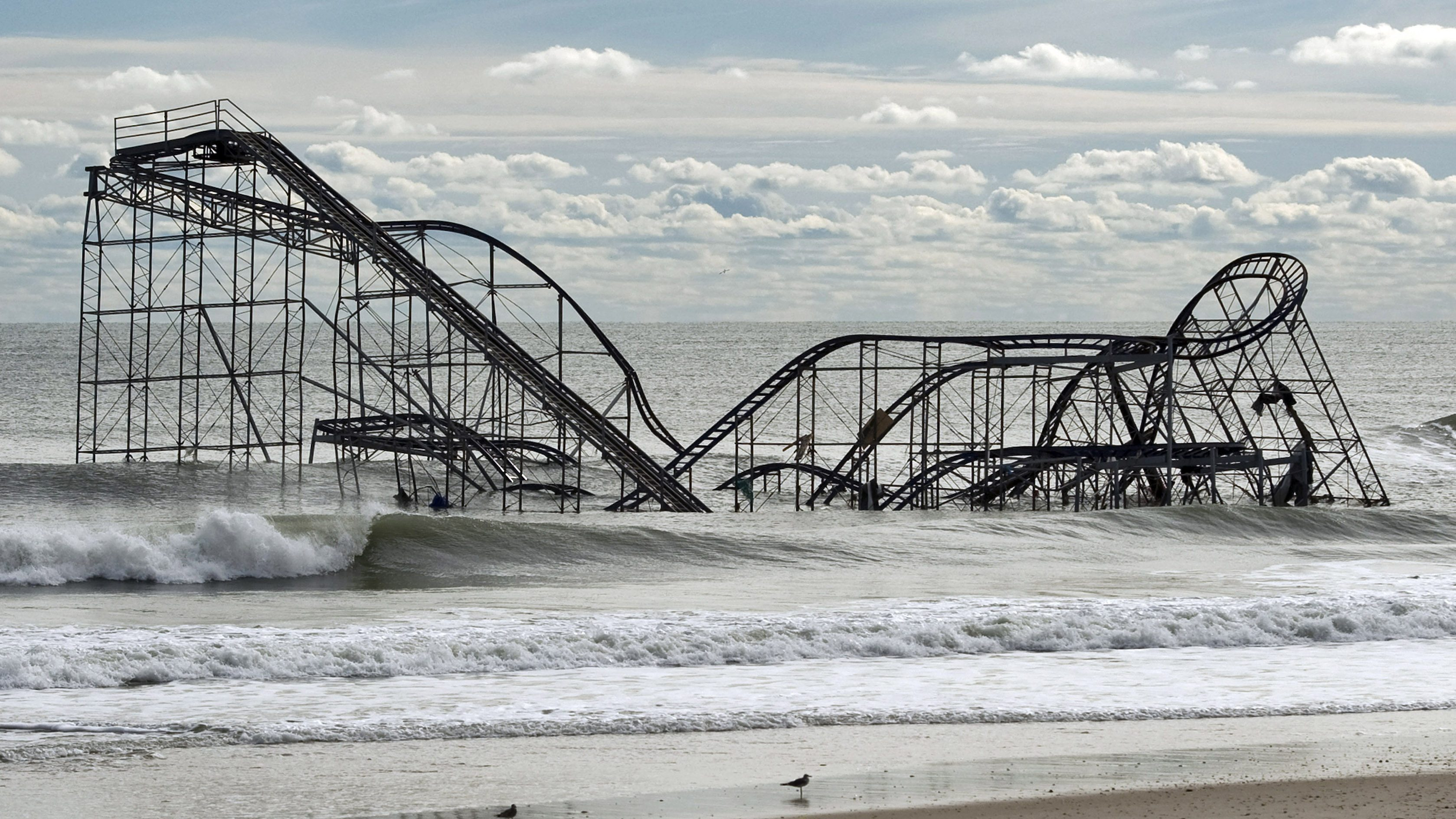 a roller coaster in the middle of an shoreline