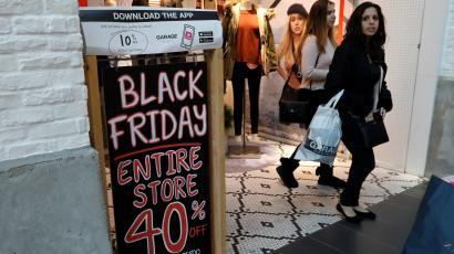 People shop during the Black Friday sales shopping event at Roosevelt Field Mall in Garden City, New York