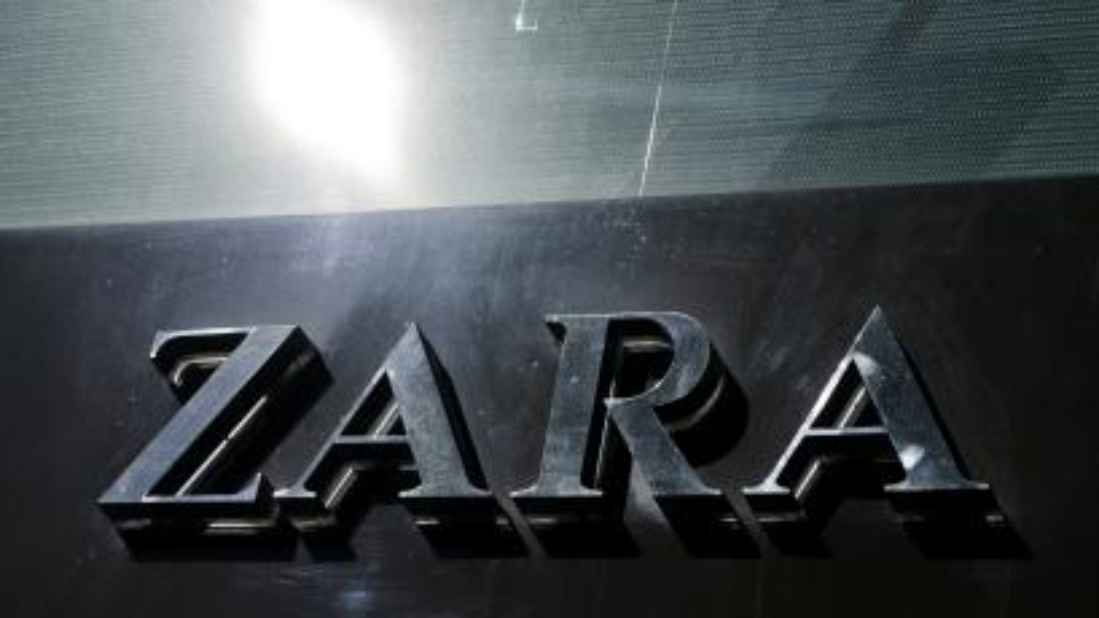 A Zara store logo shines in the sun