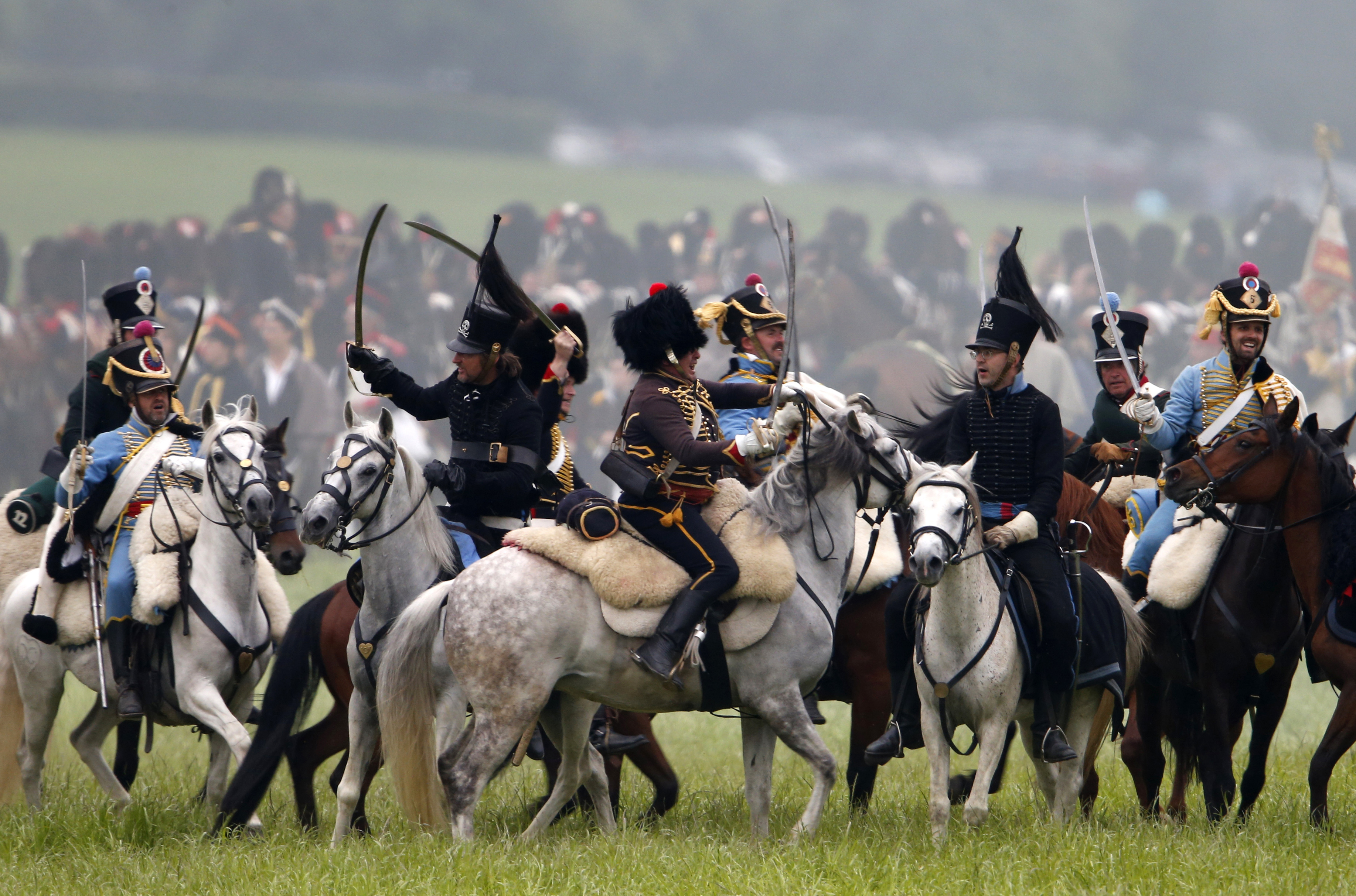 """Performers take part in the re-enactment of """"The Allied Counterattack """" battle as part of the bicentennial celebrations for the Battle of Waterloo"""