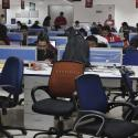 Employees of Shopclues.com work inside their office in Gurgaon