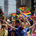 Apple employees wave rainbow flags while marching in the San Francisco LGBT Pride Parade in San Francisco, California