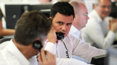A broker talks on the phone on the dealing floor at ICAP in London