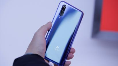 A new flagship phone Xiaomi Mi 9 is displayed after its launch ceremony in Beijing