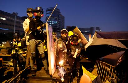 Anti-government protesters wear gas masks during clashes with police, outside Hong Kong Polytechnic University (PolyU) in Hong Kong, China, November 17, 2019
