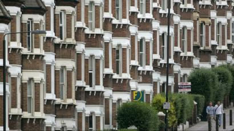 People walking down a residential street in London