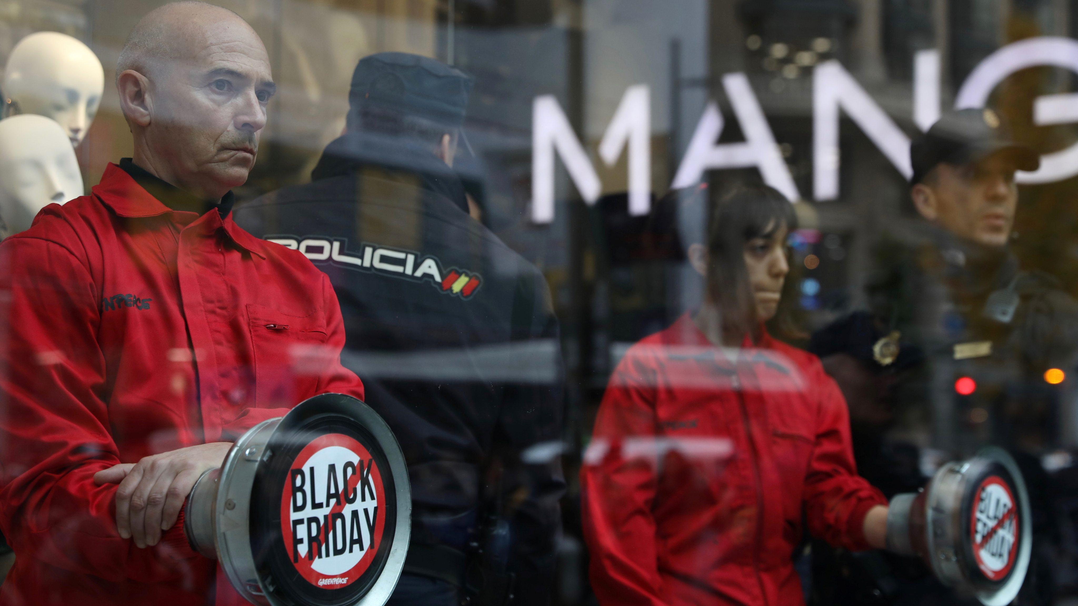 Greenpeace activists protest Black Friday inside a Mango store