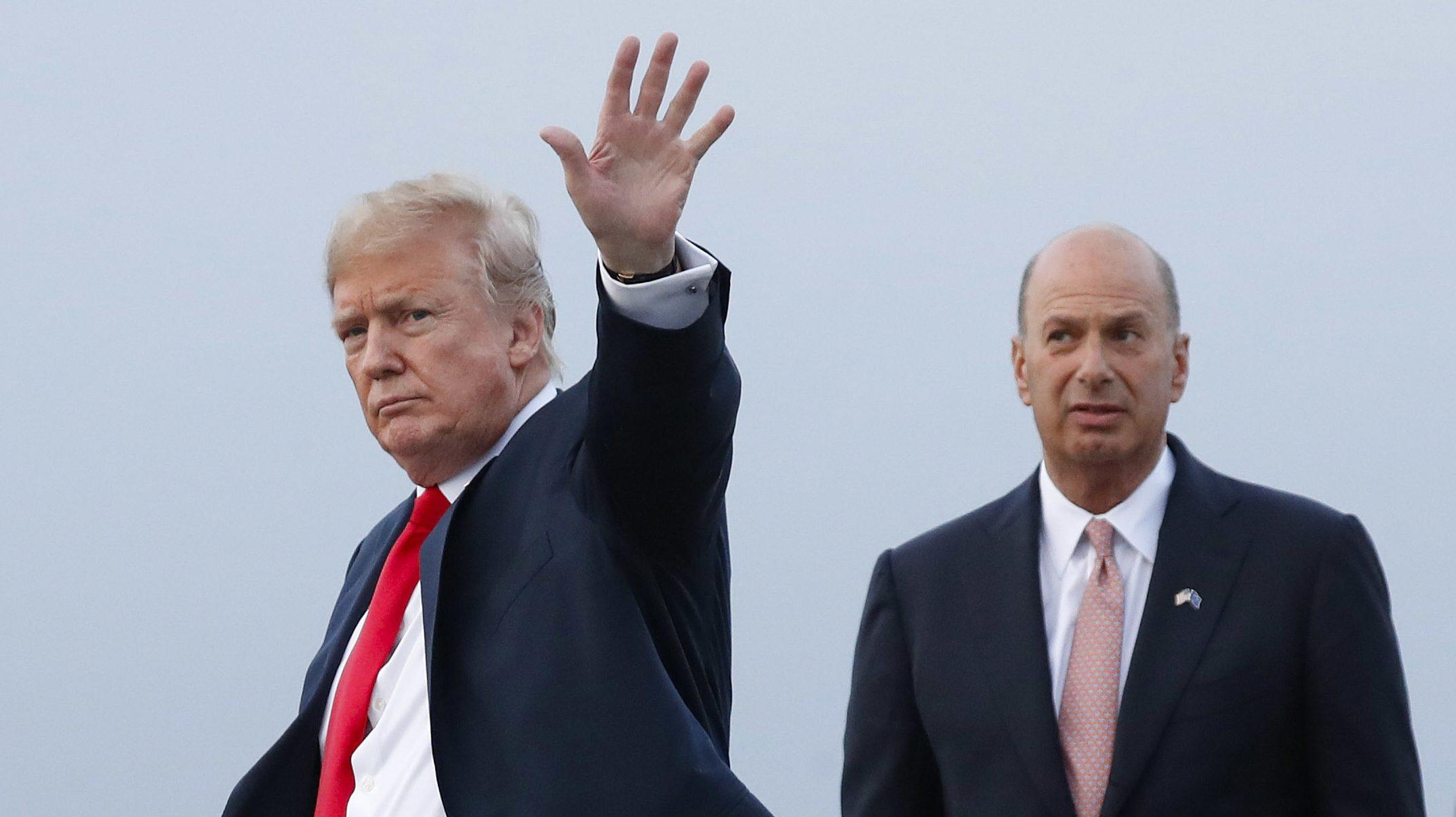 Trump waves as Sondland watches
