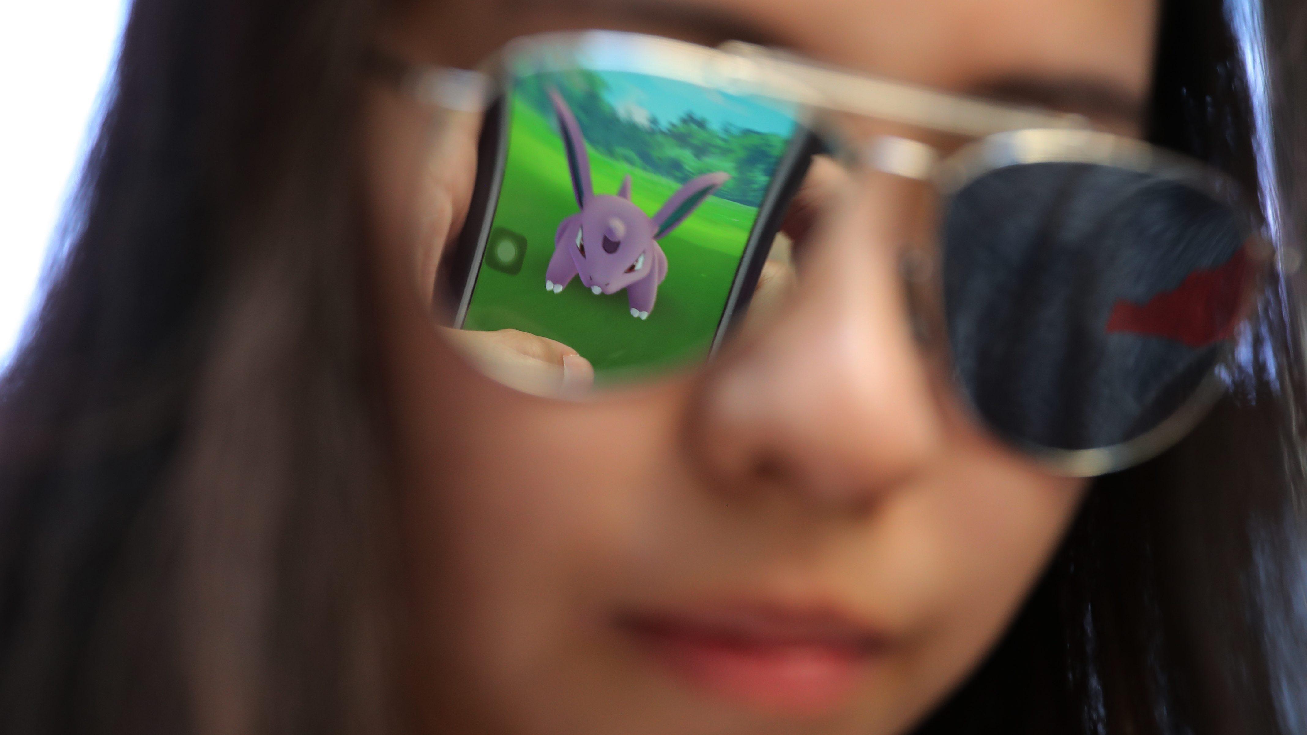 Pokemon Go reflected in sunglasses