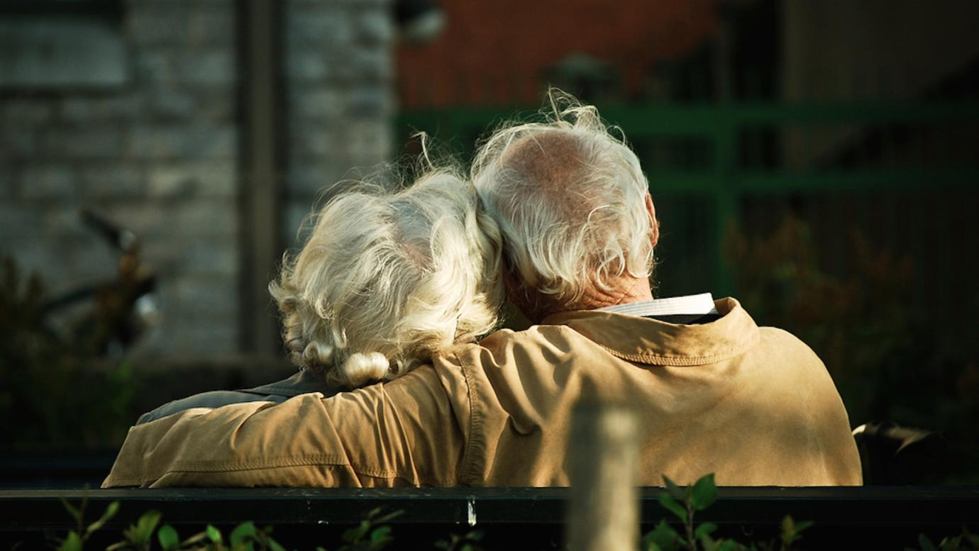 An elderly couple, sitting together