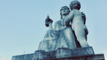 Spirit of Justice statue at US Capitol, showing mother and child.