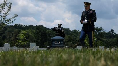 US Army Chaplain Adams departs after leading a burial service for World War II veteran Mann at Arlington National Cemetery in June 2019.