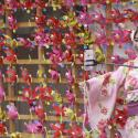 A tourist clad in traditional Japanese summer kimonos or