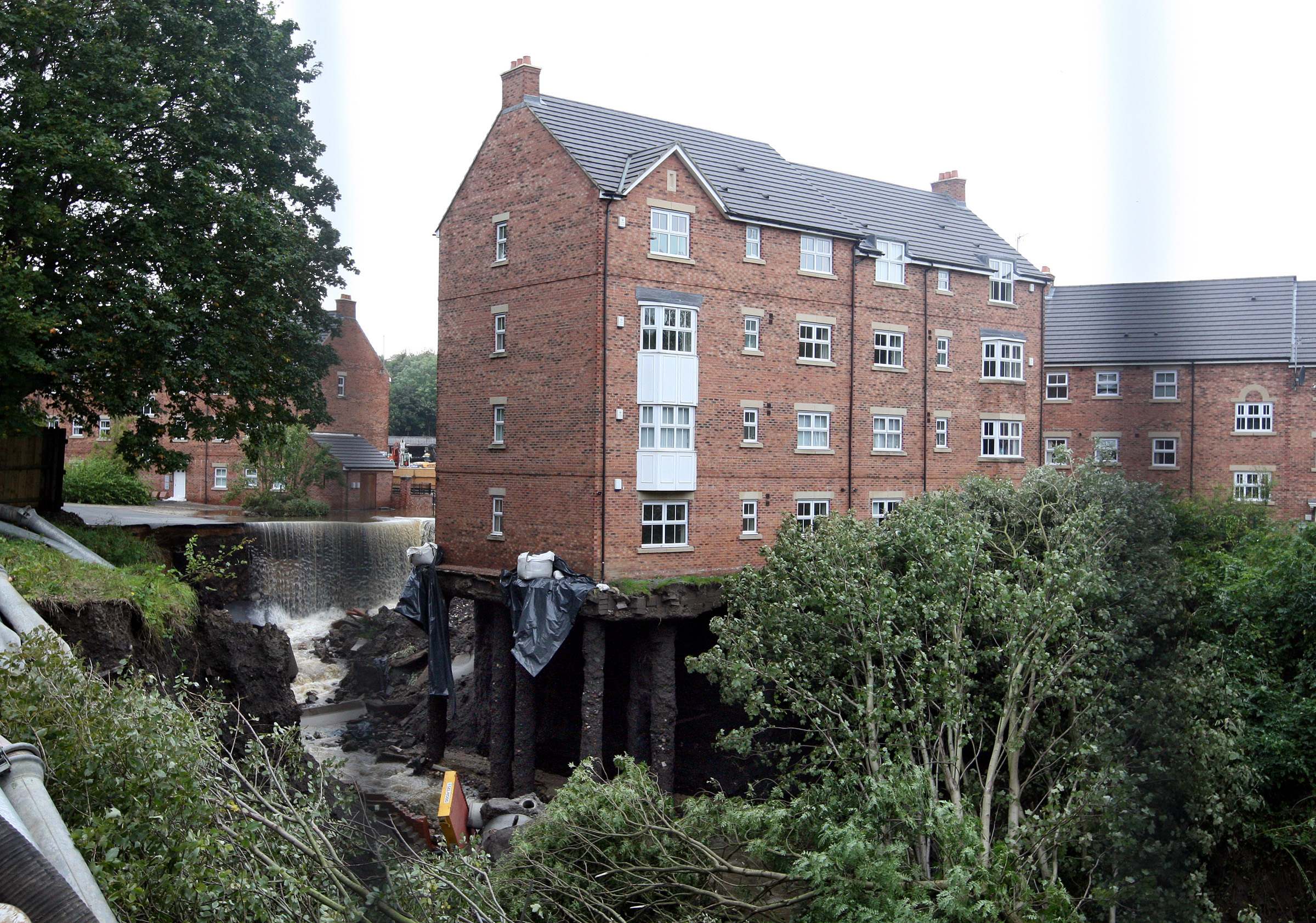 A view of the block of apartments which have there foundations washed away from the heavy flood waters in Newburn, near Newcastle, England
