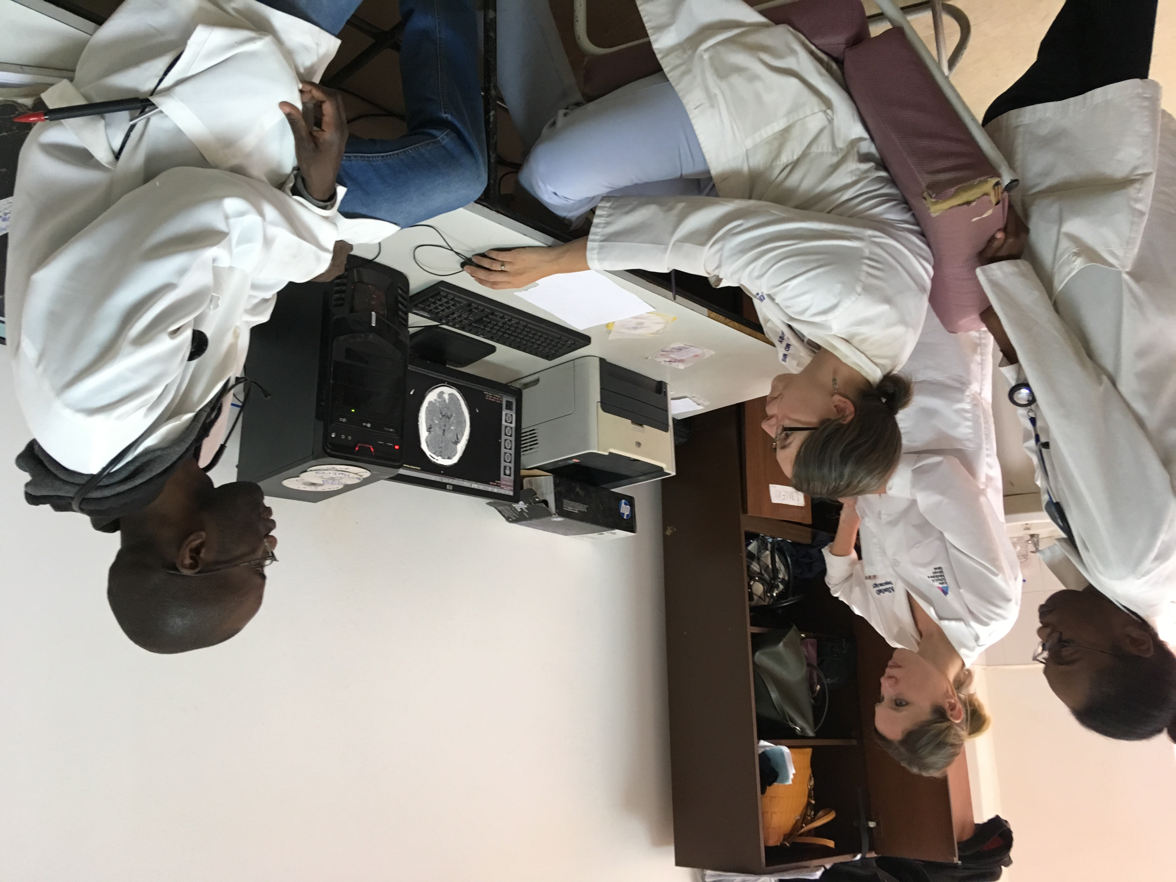 (From left) Lorraine Chishimba, Alison Navis (a visting American, Deanna Saylor and Stanley Zimba examine CT scans of UTH patients