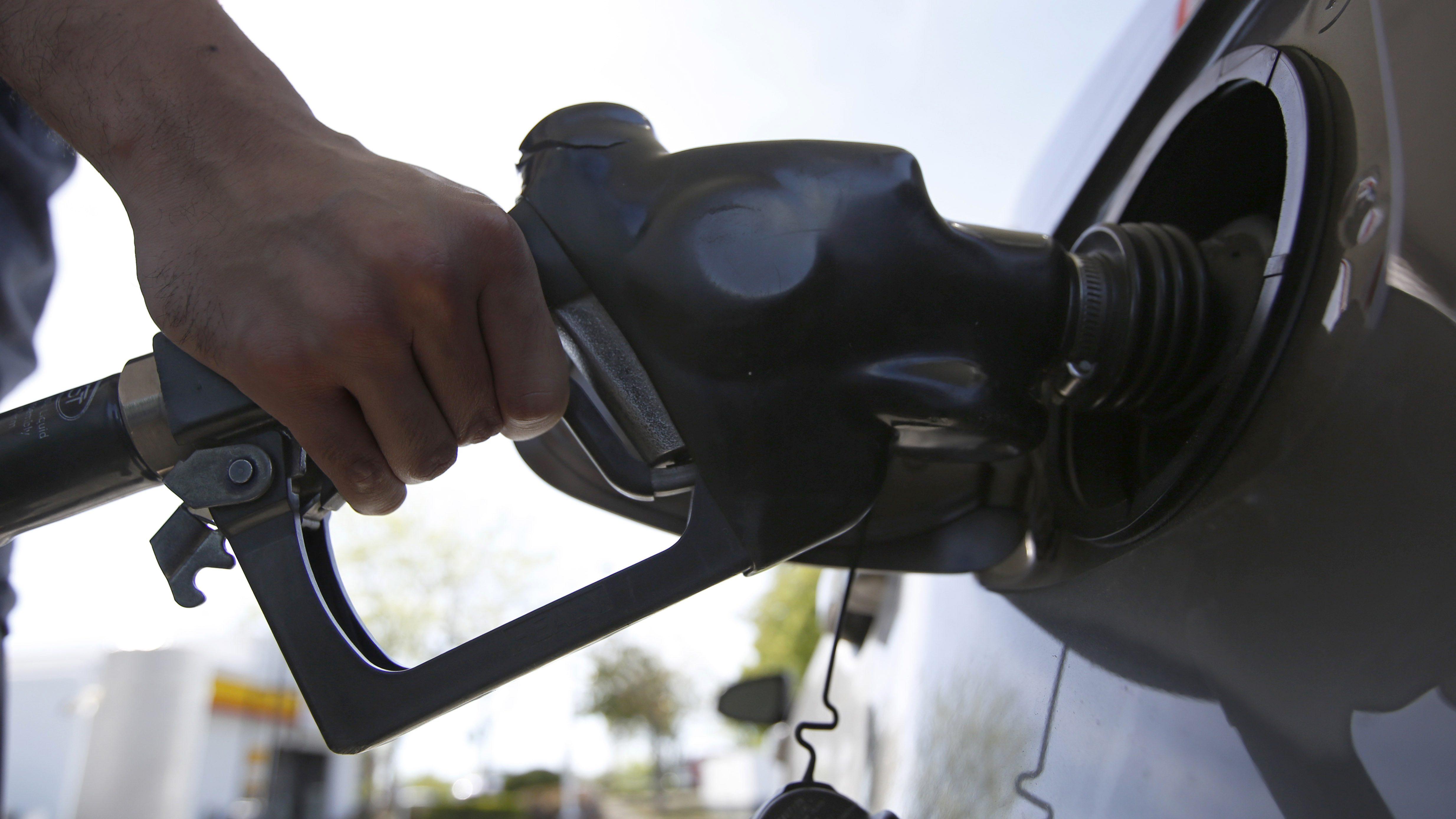 A motorist puts gas in his car
