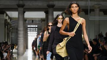 Models walk the runway at the Bottega Veneta show during the Milan Fashion Week Spring/Summer 2020
