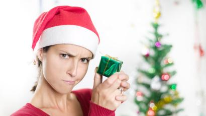 Disappointed woman with small wrapped gift