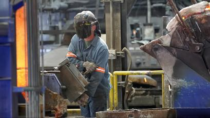 Workers pour molten metal into carbon anodes at Century Aluminum Company in Hawesville, Kentucky.