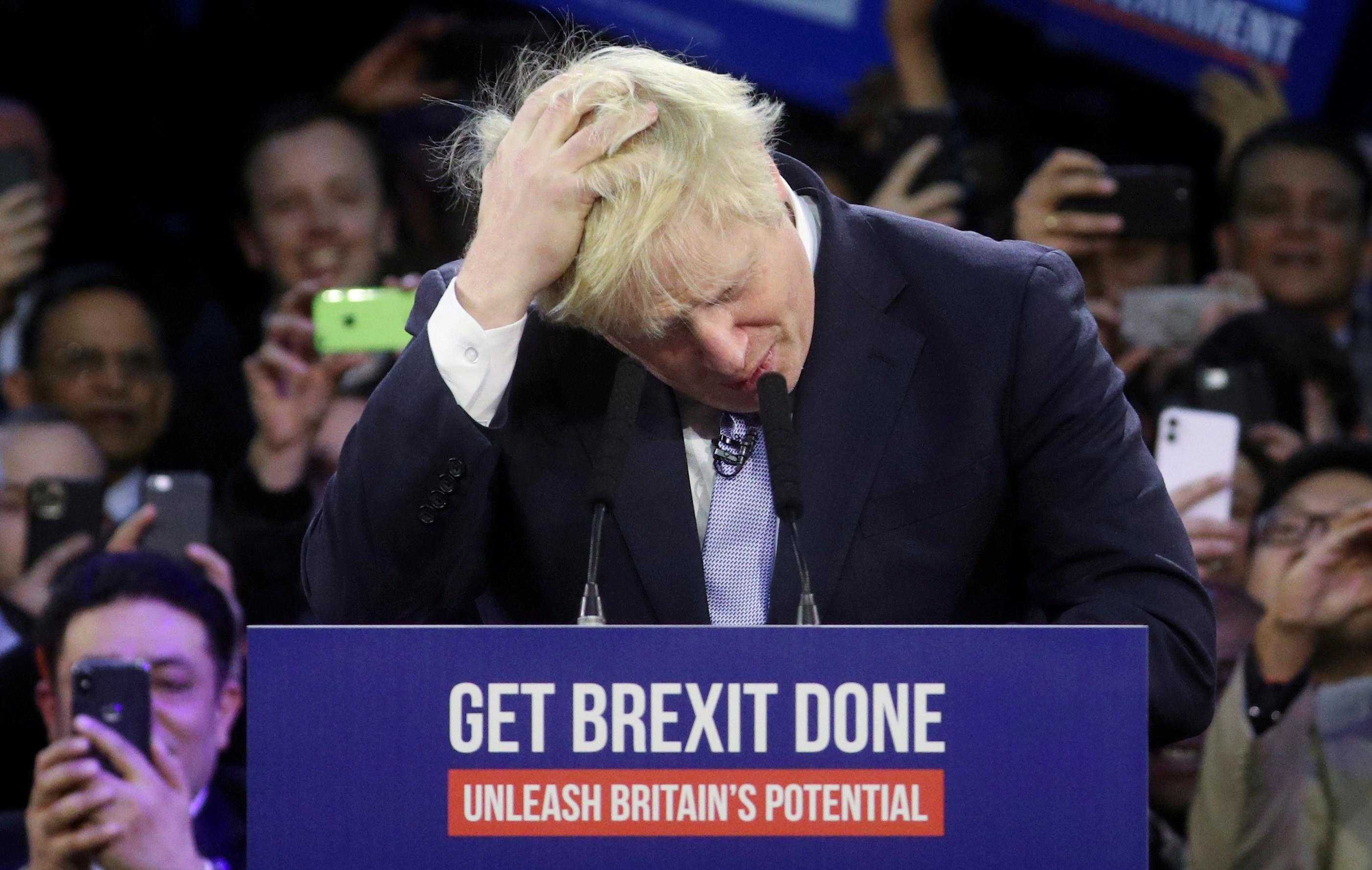 Britain's Prime Minister Boris Johnson gestures during a final general election campaign event