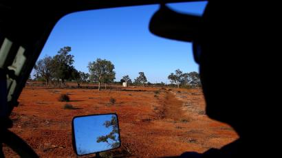 A farmer looks out on the dry landscape of Queensland, Australia
