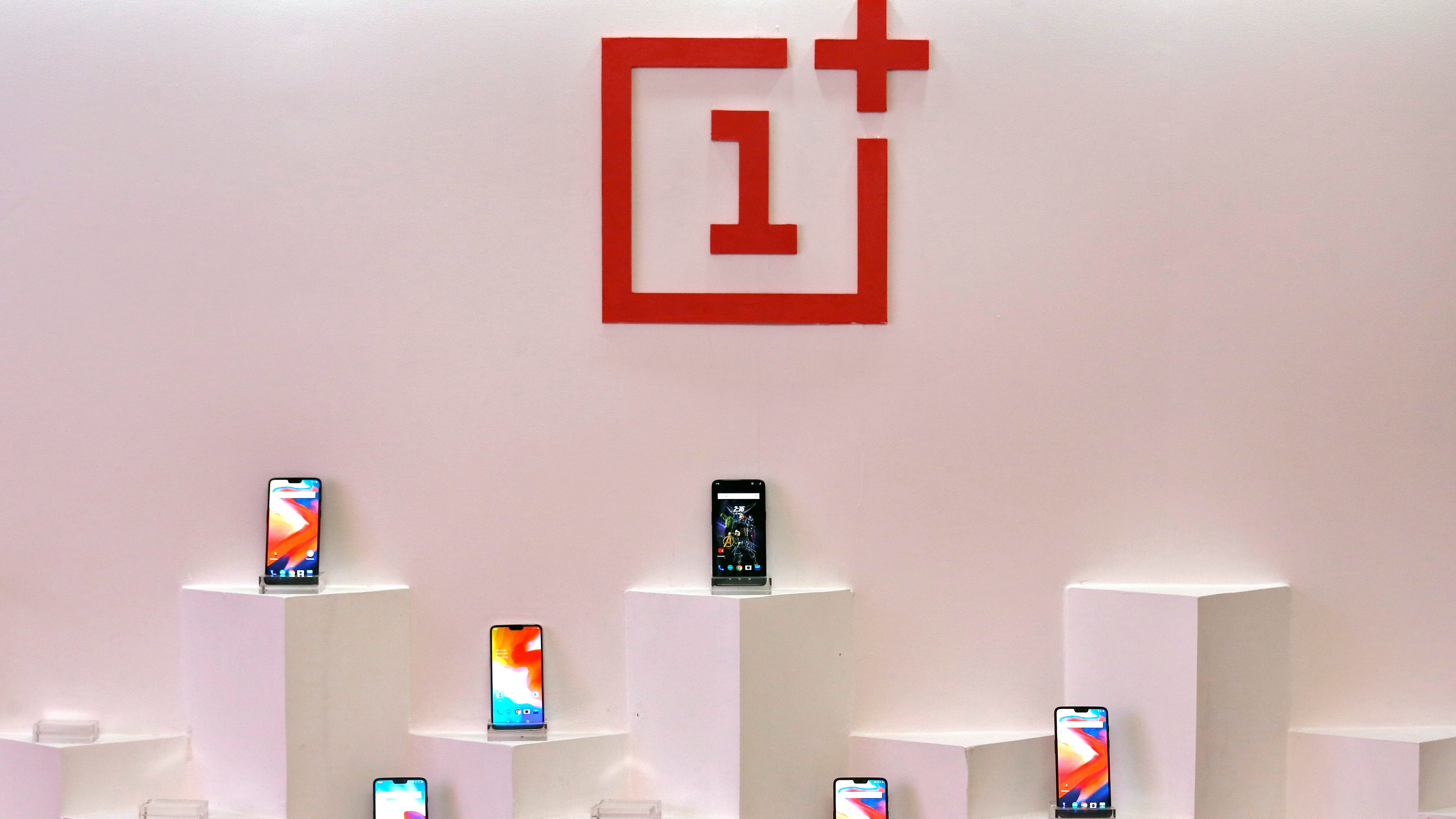 OnePlus mobile phones are seen on display during a press briefing in Mumbai