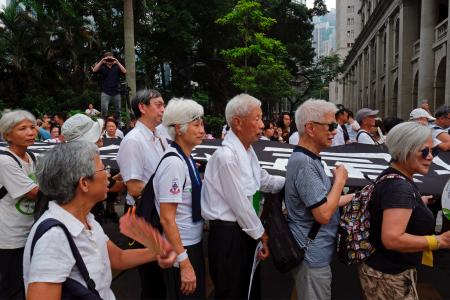 Elderly people march to protest against extradition bill in Hong Kong, China July 17, 2019.