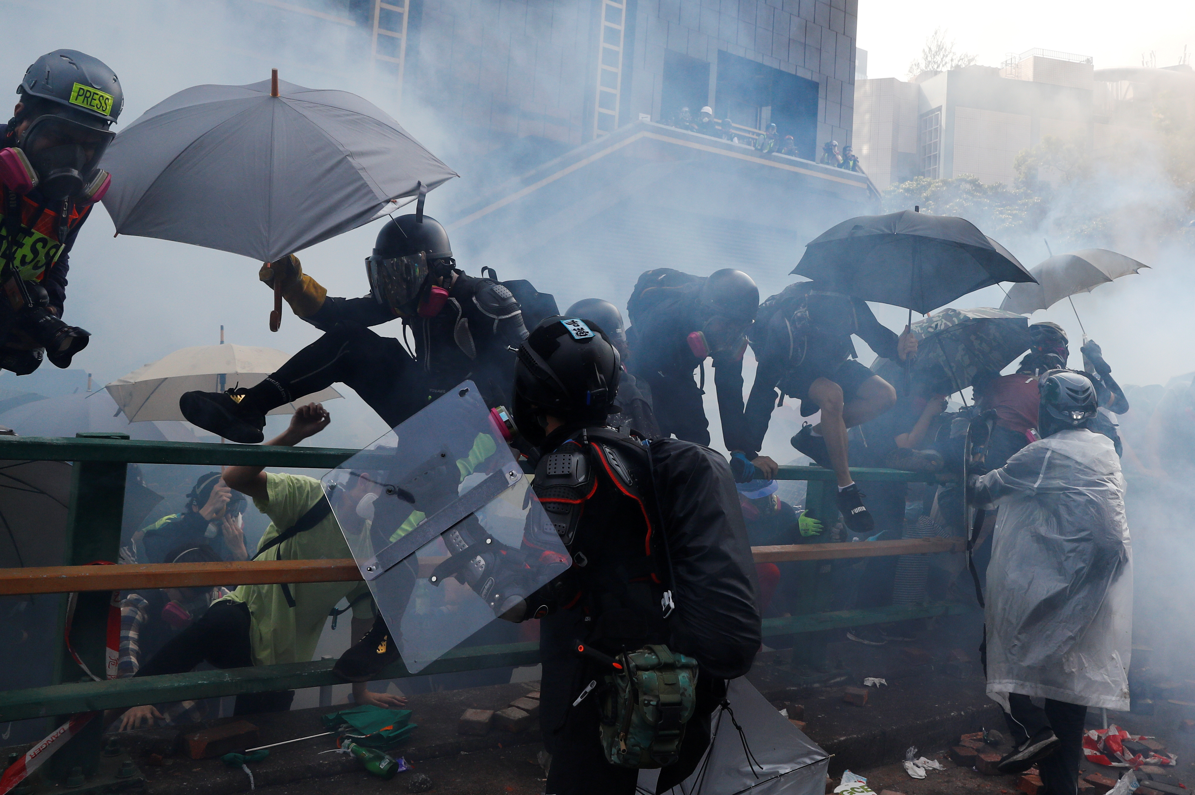 Protesters attempt to escape from tear gas while trying to leave the campus of Hong Kong Polytechnic University (PolyU) during clashes with police in Hong Kong, China November 18, 2019.