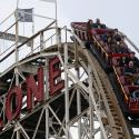 """People ride the famous wooden roller coaster """"Cyclone"""" at Coney Island, New York October 27, 2012."""