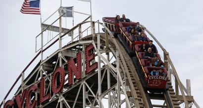 "People ride the famous wooden roller coaster ""Cyclone"" at Coney Island, New York October 27, 2012."