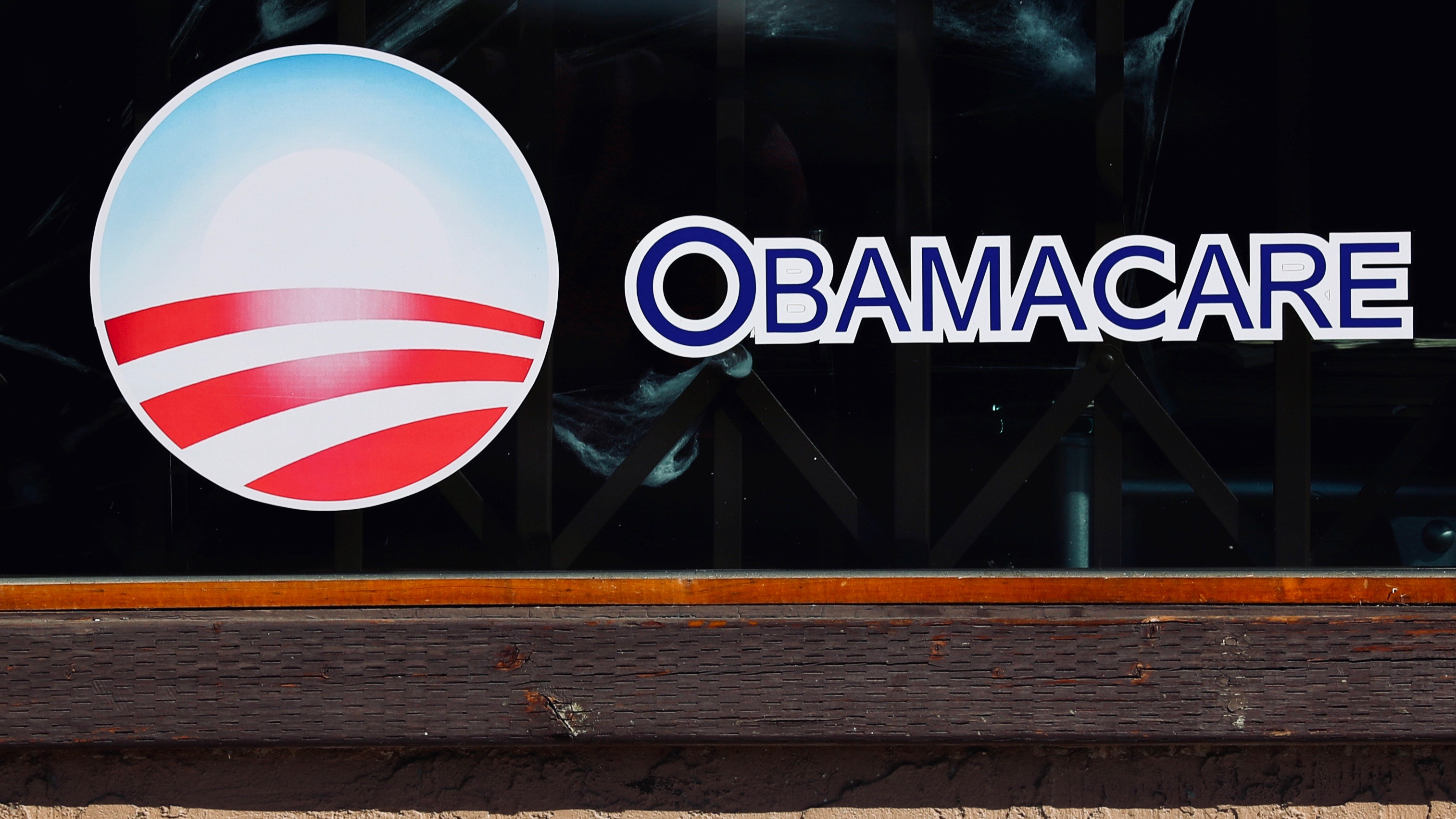 Obamacare sign in store window.
