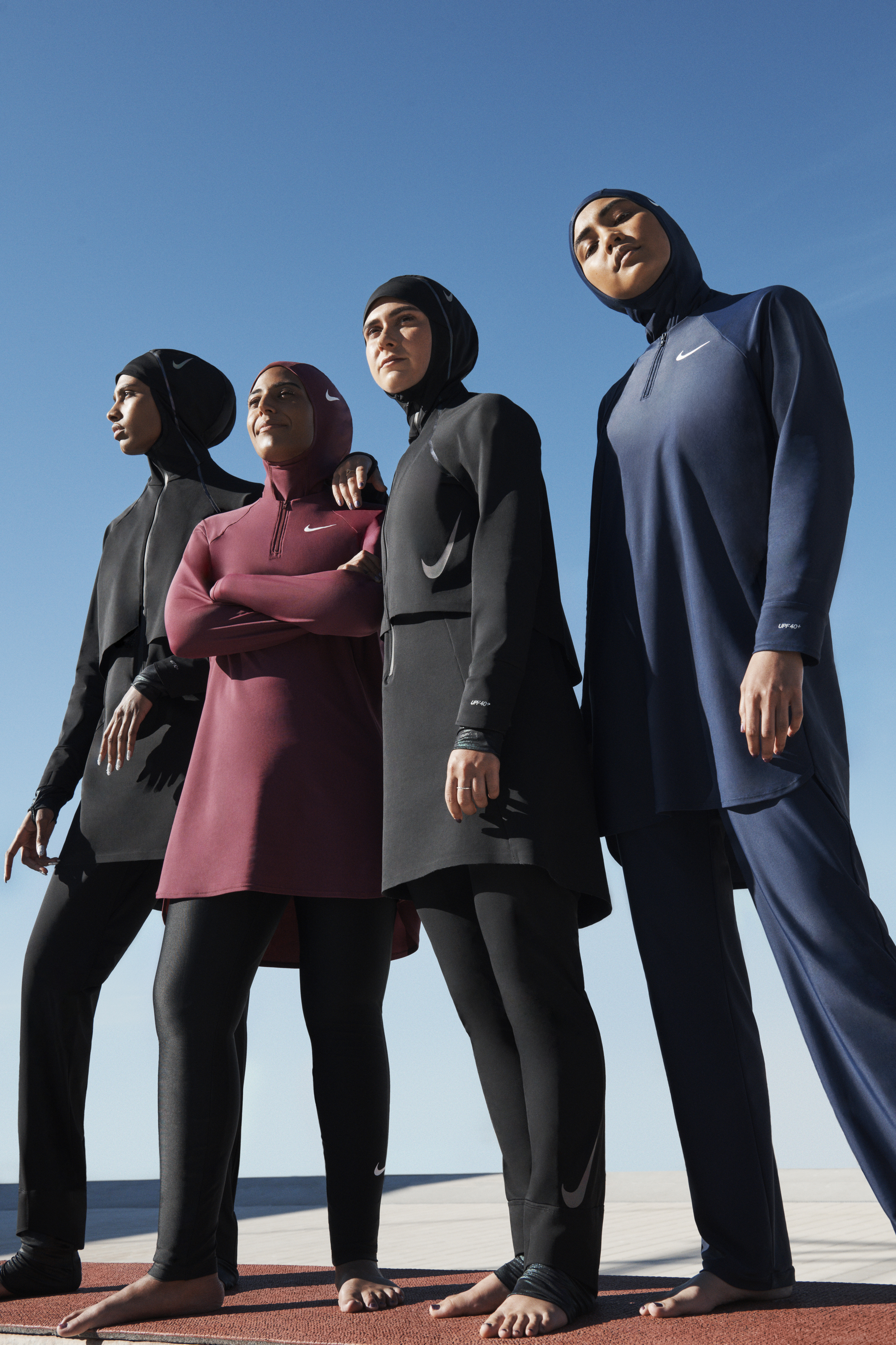 Women wearing Nike's modest swimwear