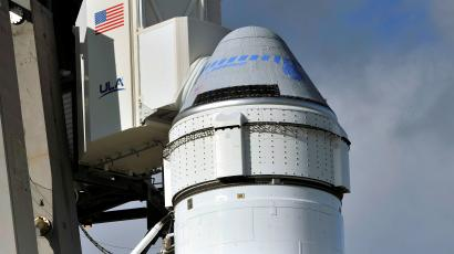 The Boeing Starliner on top of its rocket booster before launch.