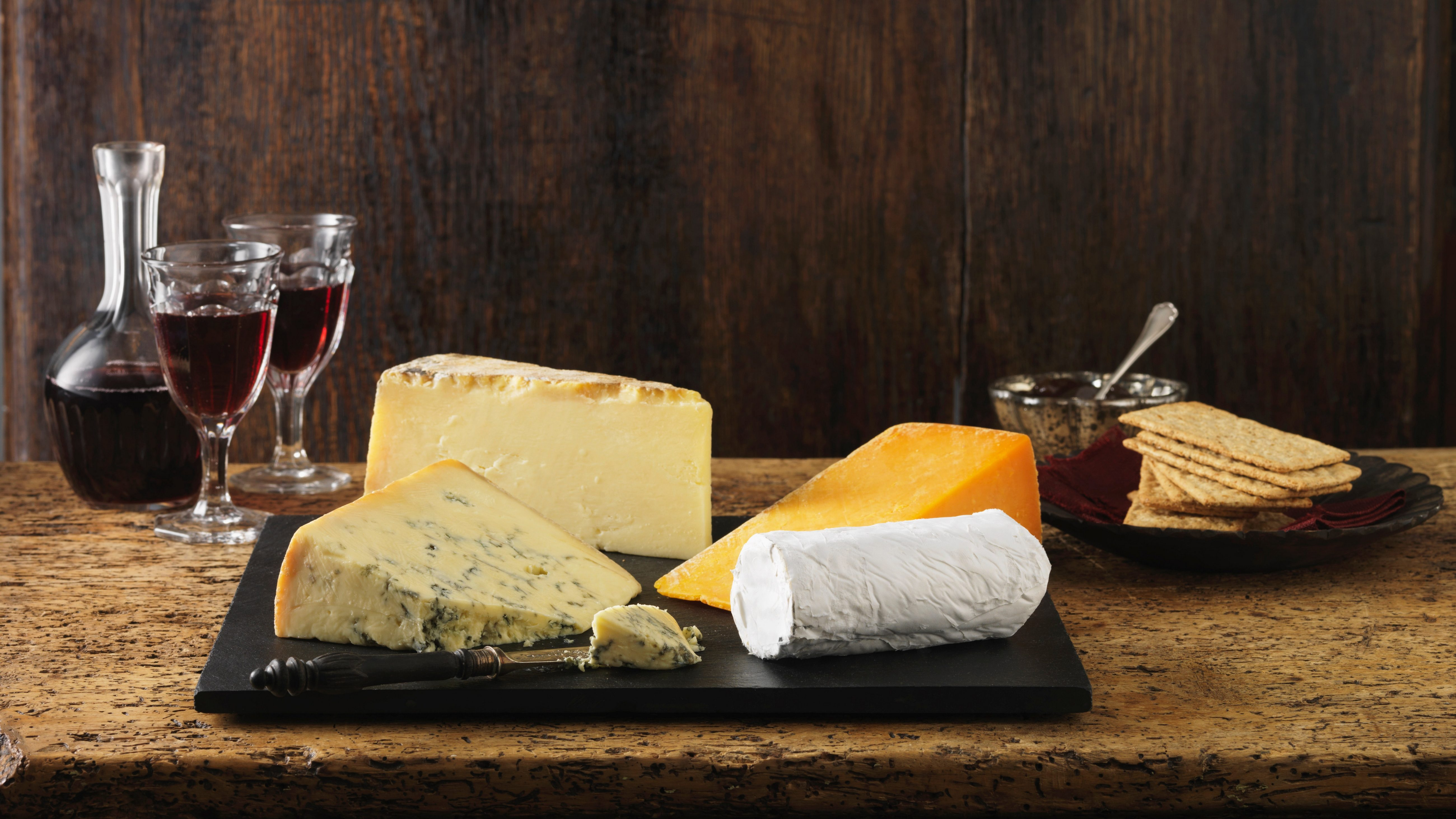 Stilton, goats cheese, red leicester and cheddar with red wine and crackers