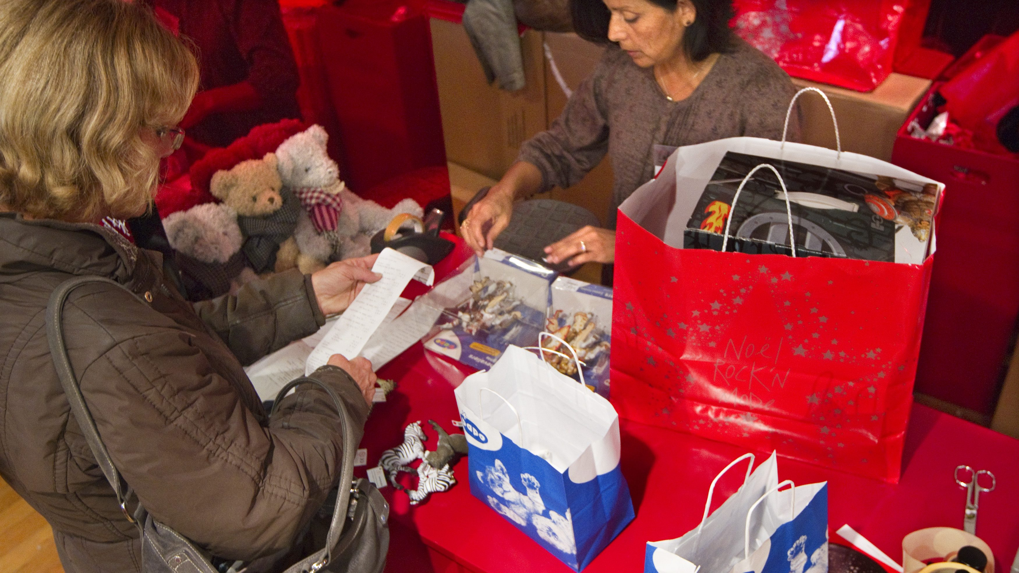 woman buying Christmas present