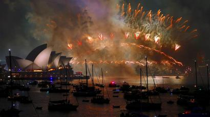 Fireworks light up the Sydney Harbour Bridge and Sydney Opera House during new year celebrations on Sydney Harbour