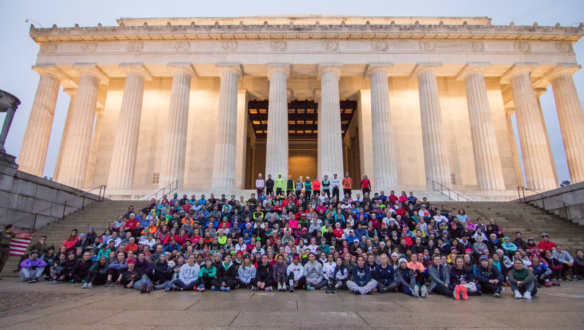 An image of a group of runners sitting on the Lincoln Memorial steps.