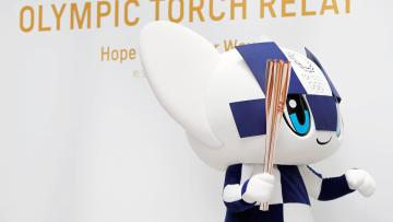 Tokyo 2020 Olympic Games mascot Miraitowa holds the torch of the Tokyo 2020 Olympic Games during a Torch Relay event to mark the 300-day milestone to the starting date of the torch relay, in Tokyo, Japan June 1, 2019.