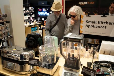 Shoppers browse a selection of kitchen appliances on display at the Amazon 4-star store in New York